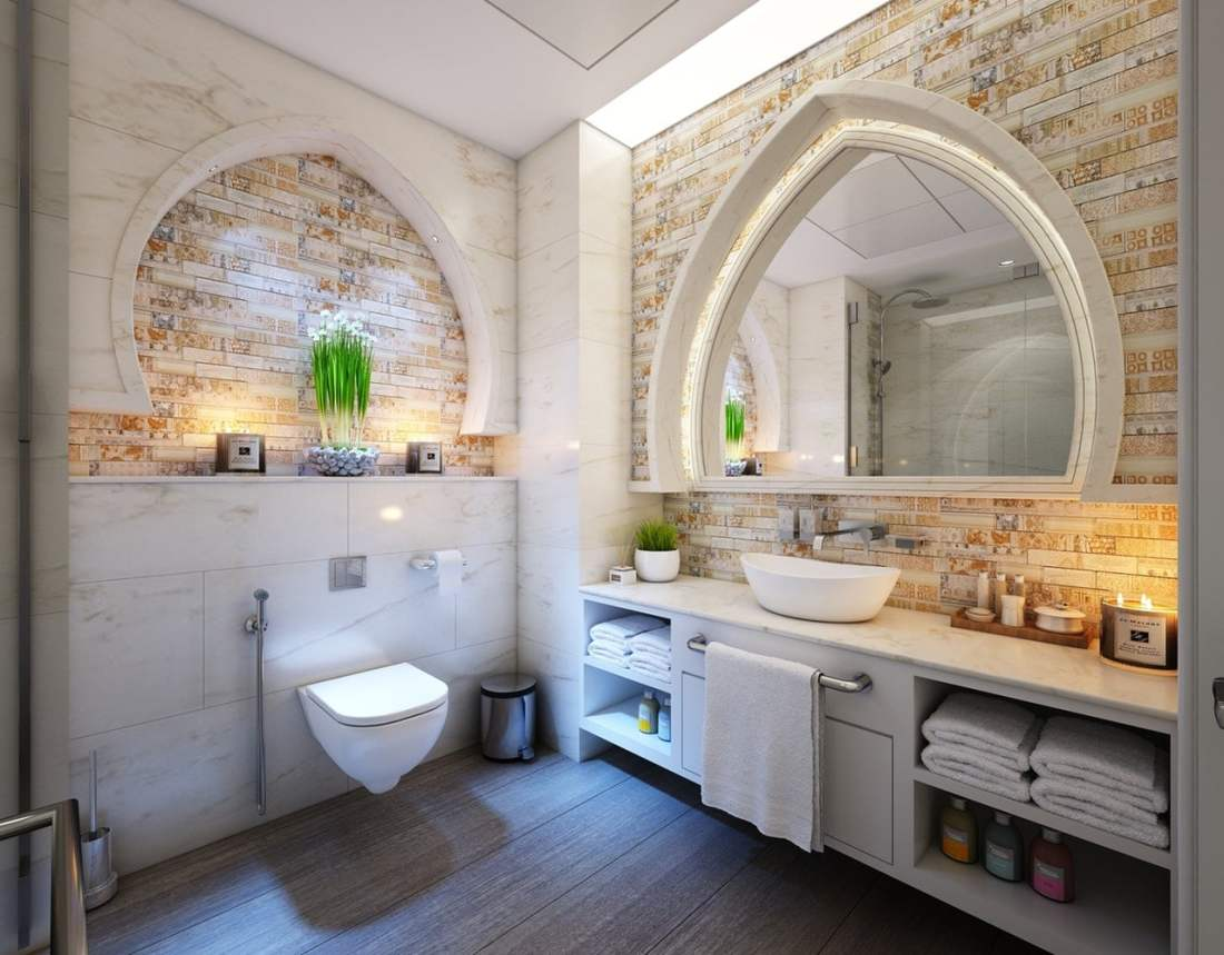 Unique Master Bathroom with Arches Mirrors and Bricks