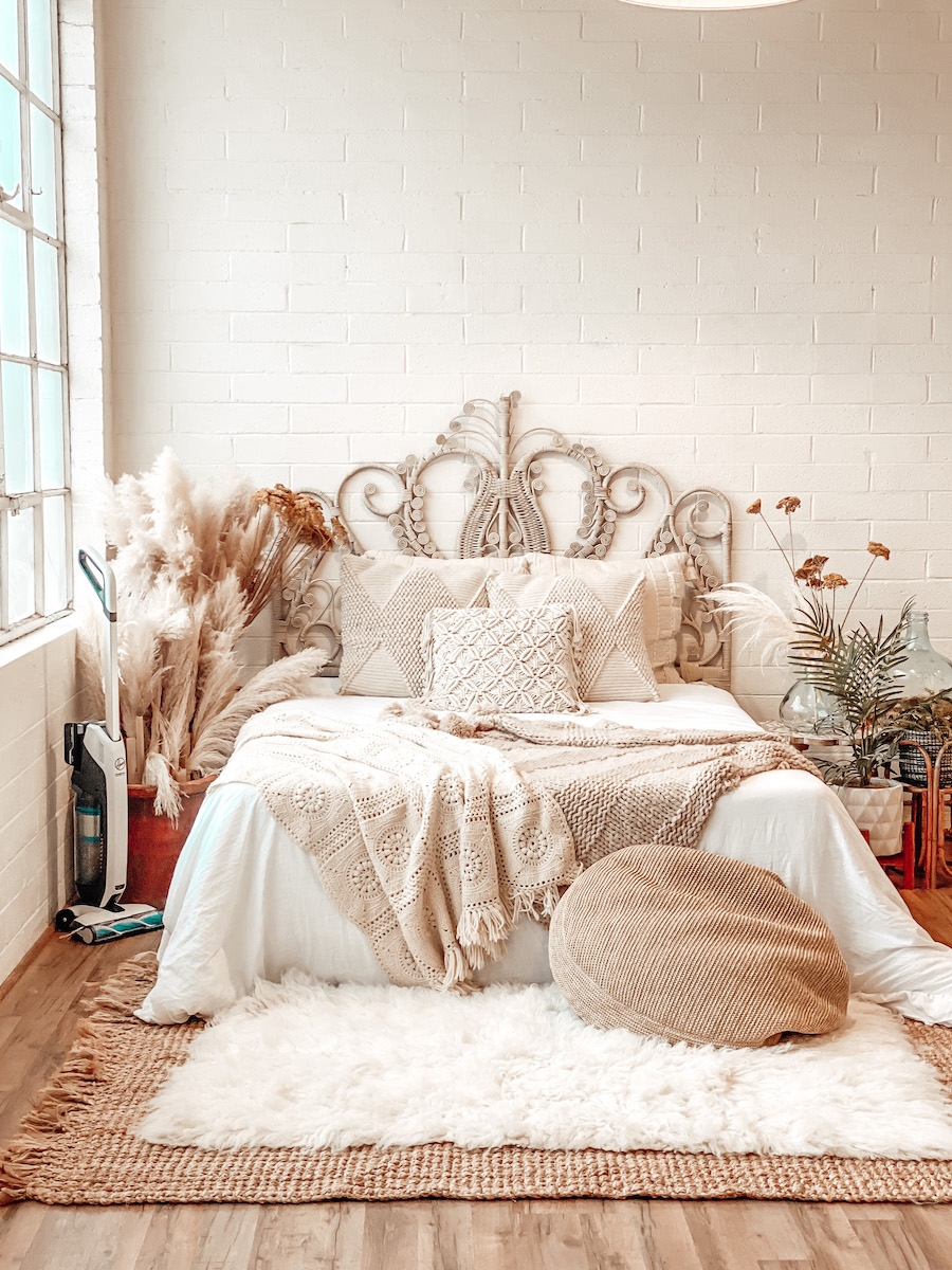 Boho bedroom with rattan and pampas grass