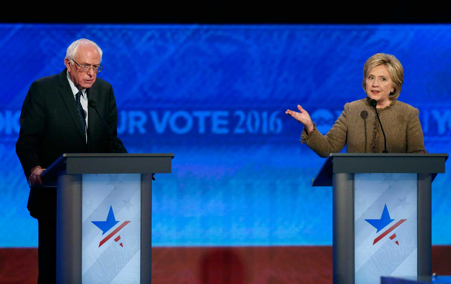 Bernie Sanders and Hillary Clinton during the Democratic presidential primary debate, Saturday, December 19, 2015, at Saint Anselm College in Manchester, New Hampshire.