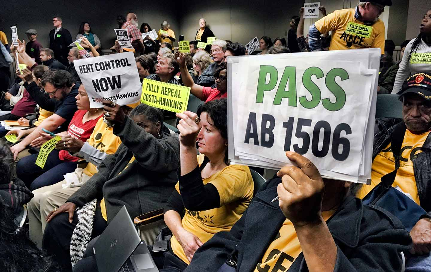 Voters Hold Signs Demonstrating Their Support For Legislation That Would  Allow California Communities To Expand Rent-Control Policies During A  Legislative