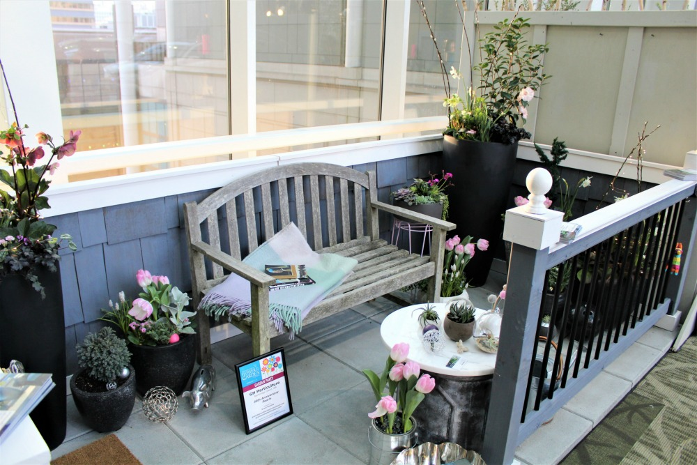 blue purple white balcony with container garden