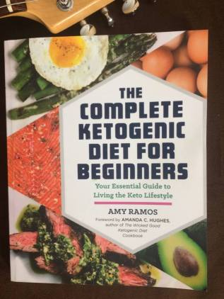 """Photograph of the book """"The Complete Ketogenic Diet For Beginners"""" by Amy Ramos."""