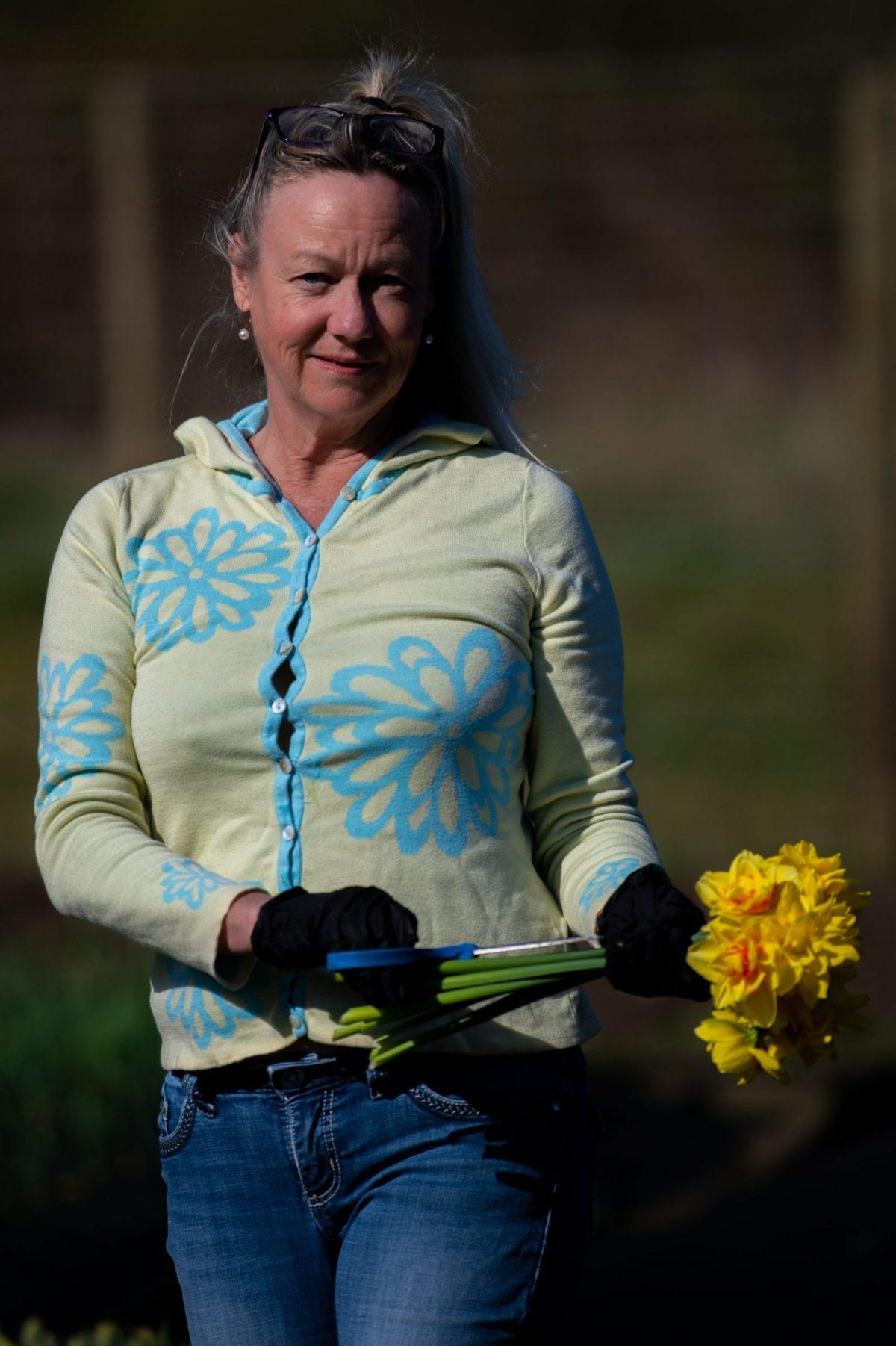 Jenny Dawson holding freshly picked daffodils