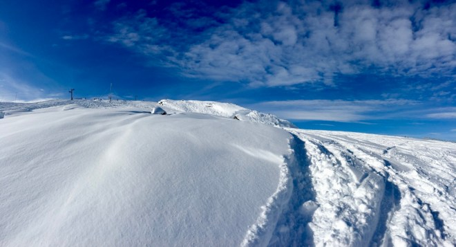 Deep snow with blue ski in Lappland