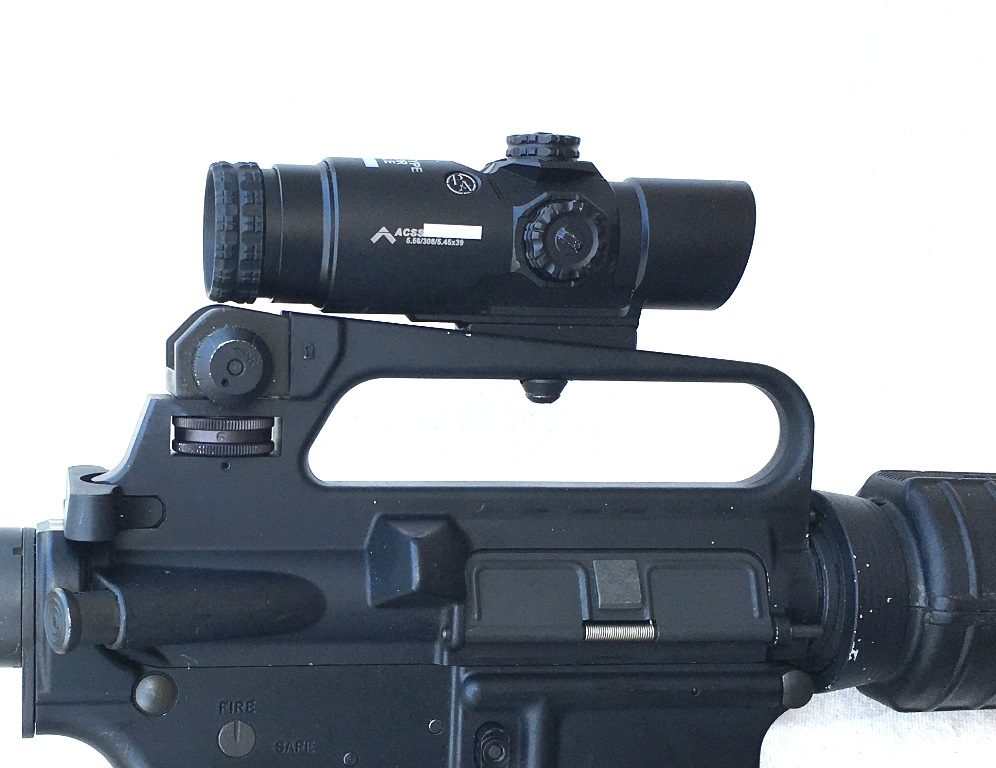 The PA fits perfectly in a carry handle with the low riser and takes the ACOG screw