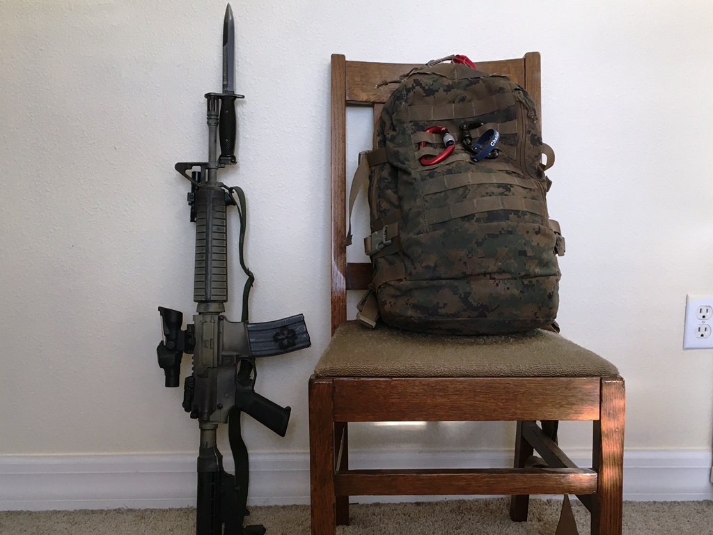 """The bayonet is on the rifle.  And the chair is against the wall. The bayonet barely fits this 14.5"""" midlength with a pinned extended flash hider. but it DOES fit."""