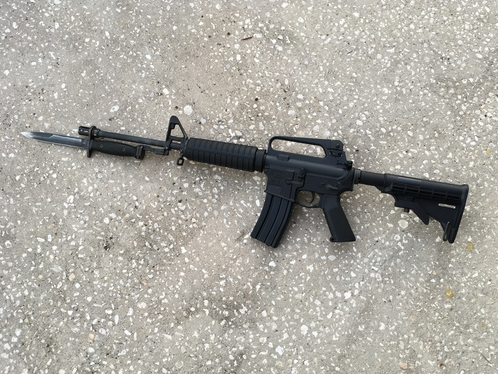 """16"""" carbine with an extender and bayonet.  This device promotes social distancing."""
