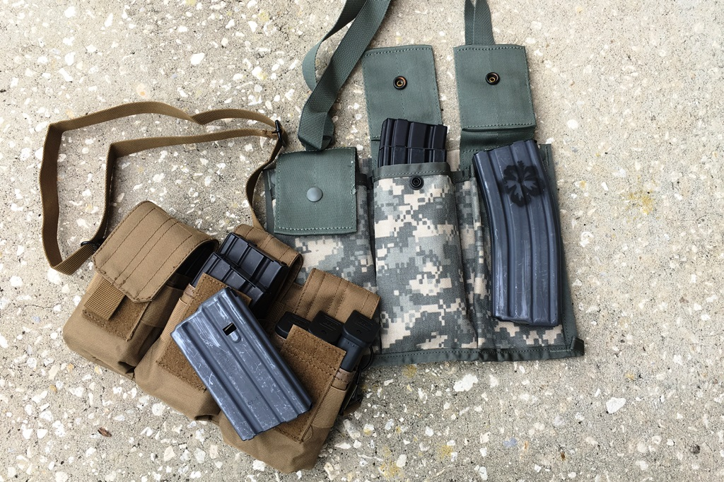 You got to carry some mags! Strikehard Gear small magazine carrier works great for 20 round mags, and surplus Army bandoleers work great for 30 round mags