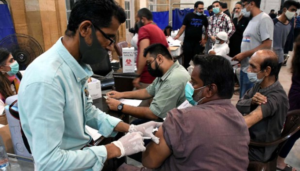 A health worker administers coronavirus vaccine to a person in Karachi. — PPI/File
