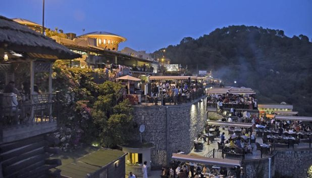 People can be seen at a restaurant at Margalla Hills in Islamabad, on June 20, 2021. — Online/File