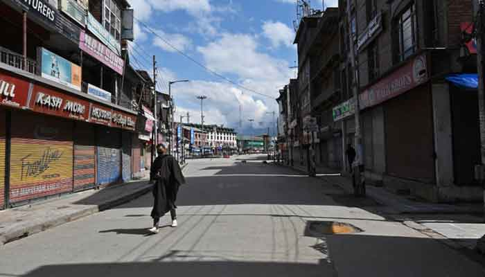 A man wearing a facemask walks along a deserted street during a government-imposed nationwide lockdown as a preventive measure against the COVID-19 coronavirus, in Azad Kashmir on March 29, 2020. — AFP