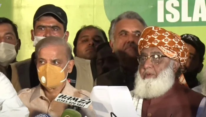 JUI-F and PDM chief Maulana Fazlur Rehman (right) along with Opposition Leader in the National Assembly and PML-N Shahbaz Sharif (left) address a press conference in Islamabad, on August 11, 2021. — YouTube