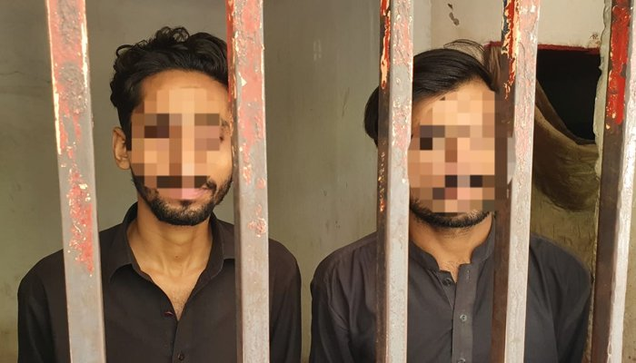 Arrested suspects behind the bars. Photo Geo News
