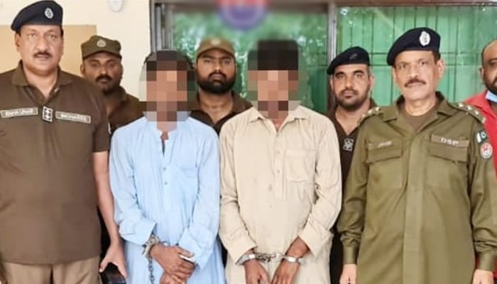Arrested suspects stand handcuffed. Photo Geo News