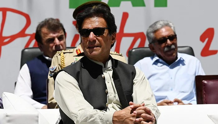 Prime Minister Imran Khan (C) attends an event after planting a tree during his visit to inspect the progress of 10 Billion Tree Tsunami campaign in Makhniyal area of Haripur district, in northwest Khyber Pakhtunkhwa on May 27, 2021. — AFP/File