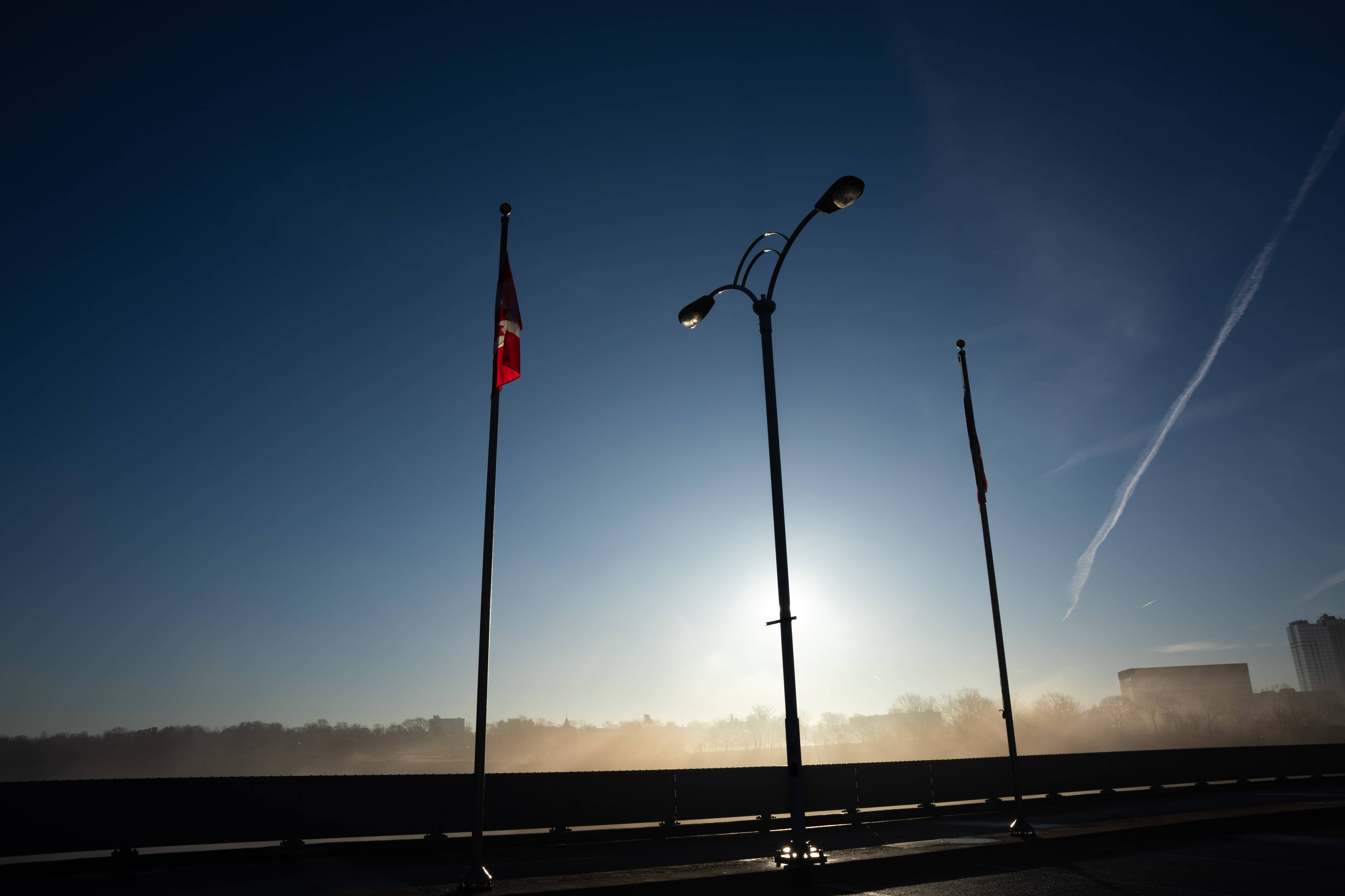 Looking northeast on Rainbow International Bridge. The Canadian Flag is on the left and the American flag is to the right.