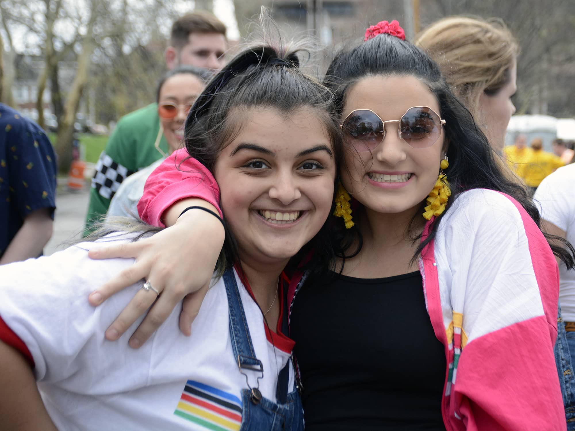 Libby Welch and Gia Marcoglies make their way to Mayfest 2019 at Walnut Park.