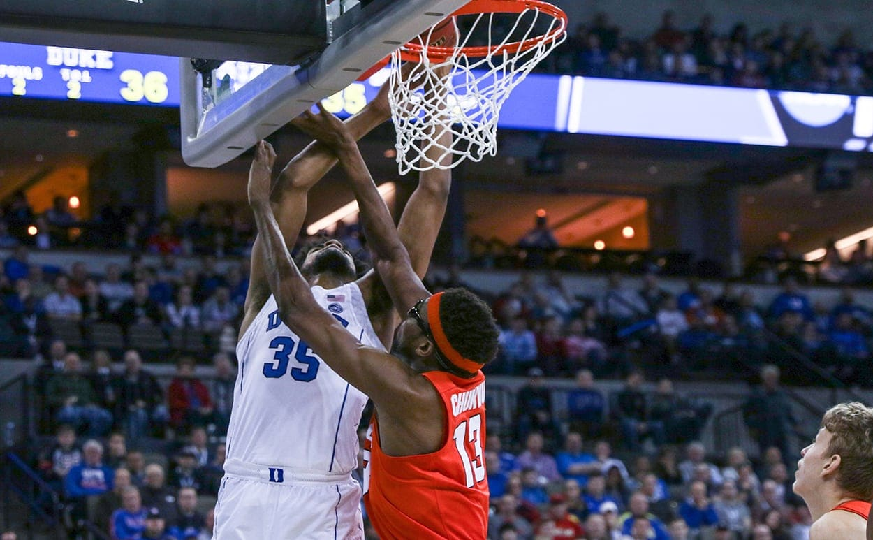 Paschal Chukwu tries to block a shot in Syracuse vs. Duke - Sweet 16 game in Omaha, Neb.