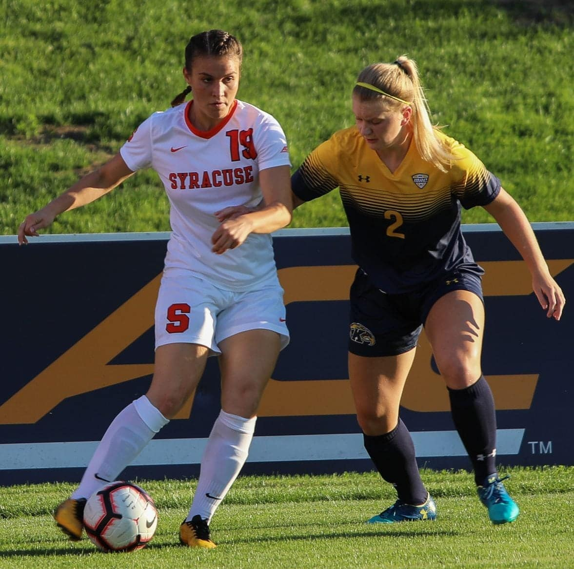 Syracuse Forward Drina Domic Fends Off a Kent State Defender