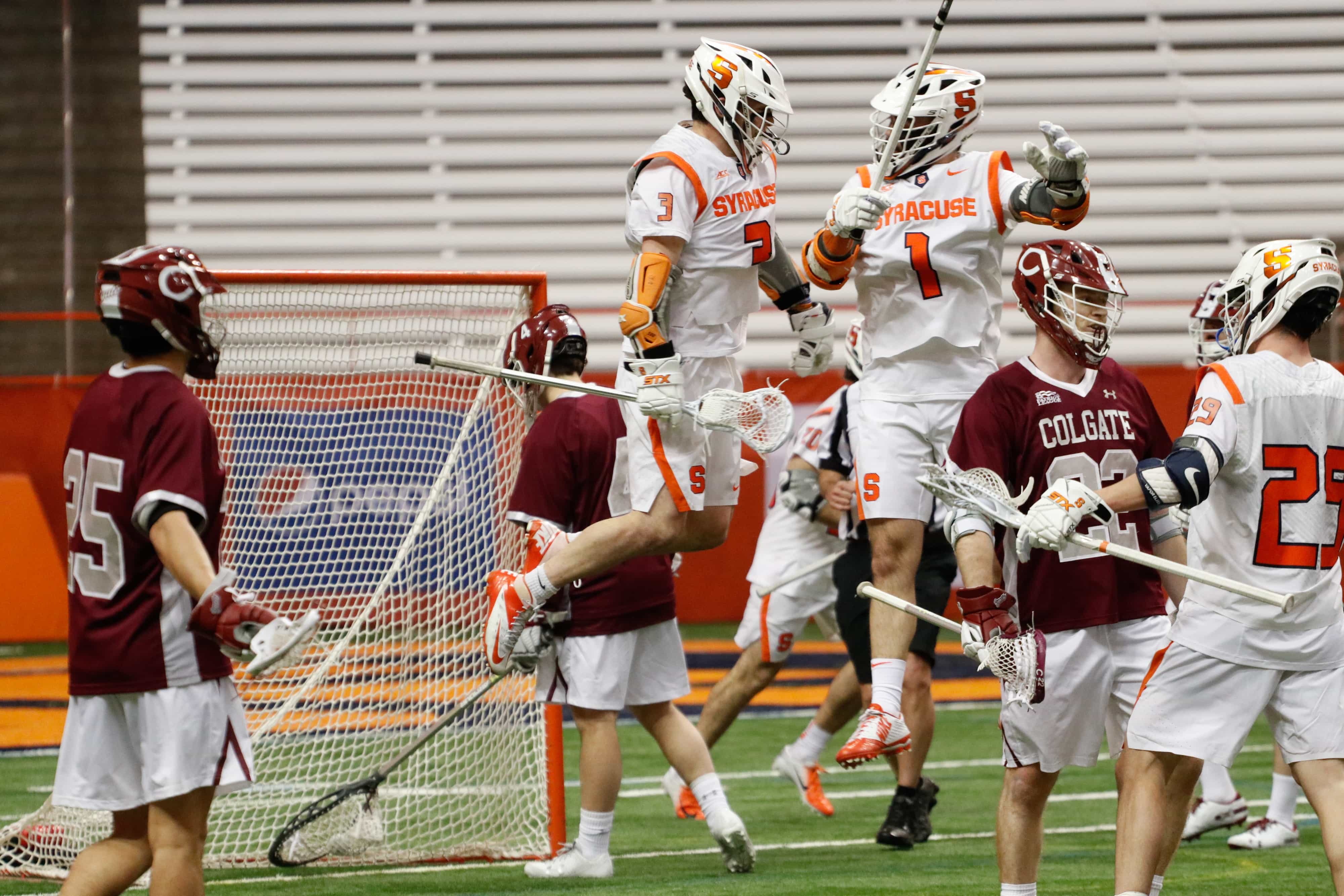 Bradley Voigt and Nate Solomon celebrate after scoring a goal against Colgate in the 2019 season opener in the Carrier Dome.
