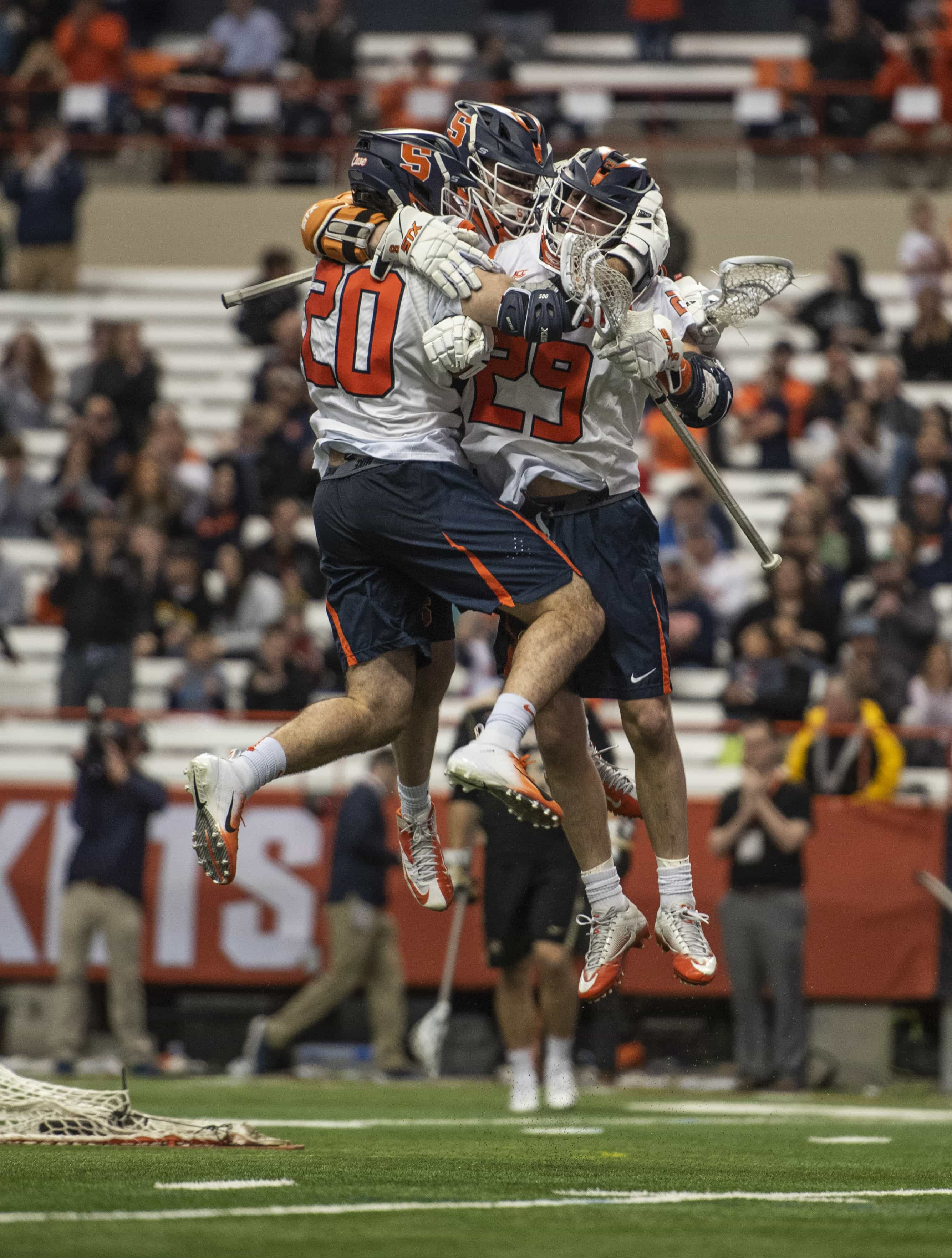 Syracuse players celebrate after scoring the final goal of the 10-8 win over Army.