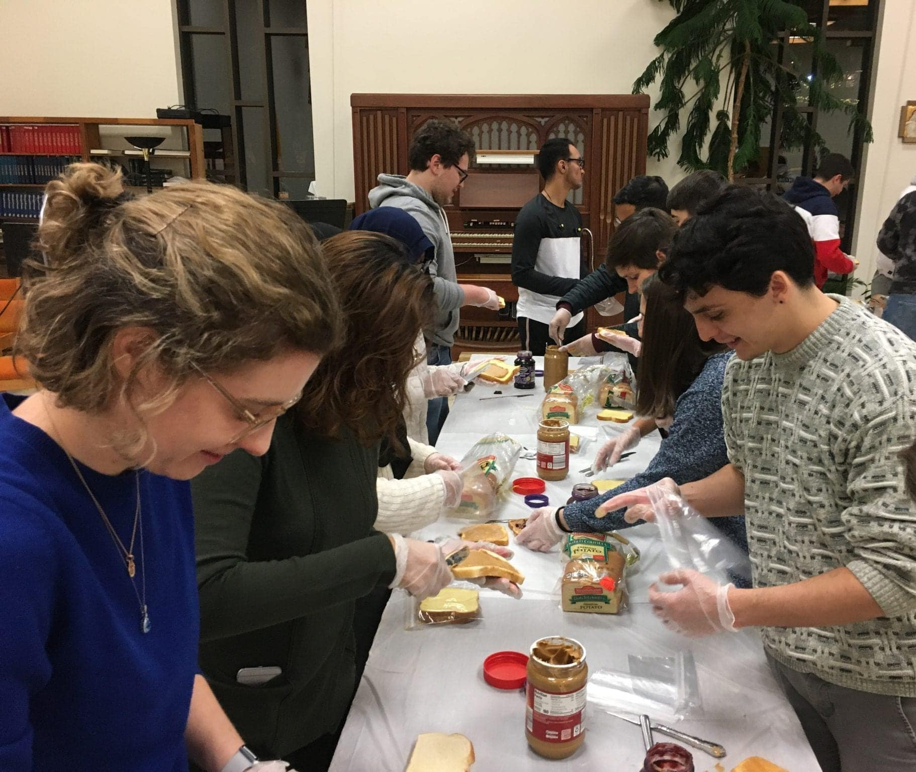 Students and faculty from different religious associations on campus came together to make PB&J and turkey sandwiches to donate to the poor at the Samaritan Center and Assumption Church Food Pantry