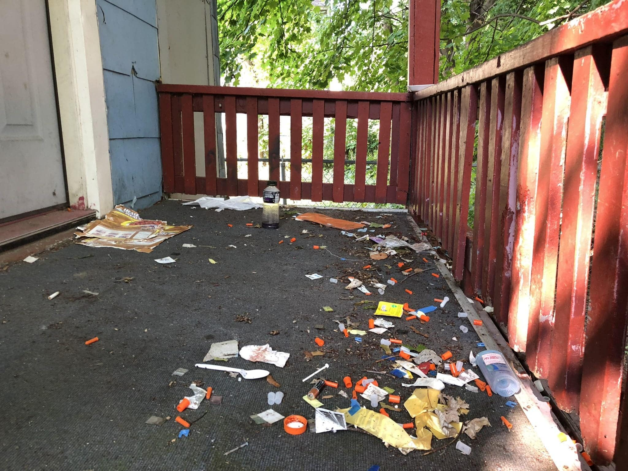 A Syracuse porch covered in used syringes is representative of the opioid crisis.