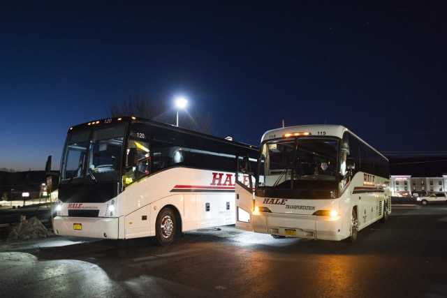 Two of the three Syracuse Student Association sponsored busses park during a rest stop in Pennsylvania. The caravan of busses with around 150 students left Syracuse at 2:30 AM.