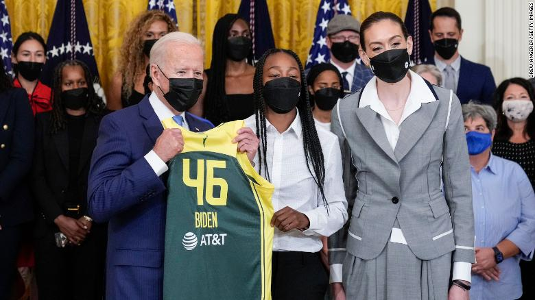 President Joe Biden holds up a Seattle Storm jersey gifted to him by the 2020 WNBA champion Seattle Strom's Jewell Loyd and Breanna Stewart.  Source: Drew Angerer, Getty Images.