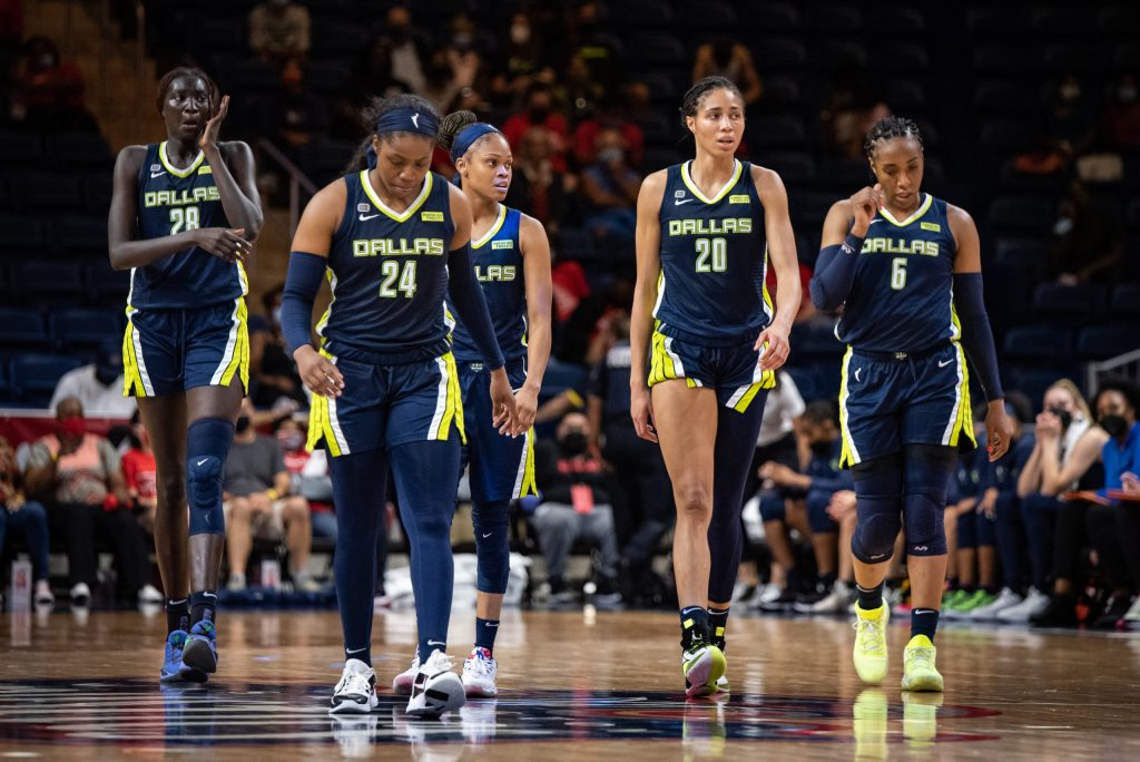 The Dallas Wings walk onto the court during a game against the Washington Mystics on Aug. 26, 2021. (Photo credit: Domenic Allegra)