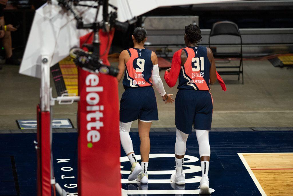Natasha Cloud (9) and Tina Charles (31) of the Washington Mystics walk off the court at the Entertainment and Sports Arena in Washington, DC, on June 5, 2021. (Photo credit: Domenic Allegra)