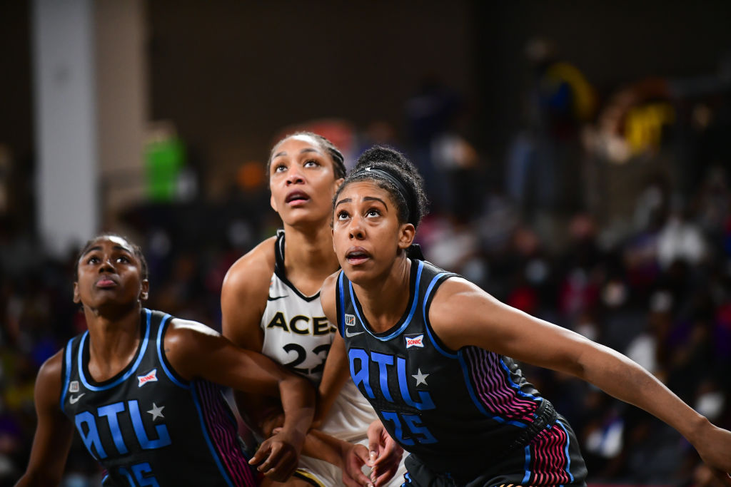 ATLANTA, GA - AUGUST 26: A'ja Wilson #22 of the Las Vegas Aces and Monique Billings #25 of the Atlanta Dream fight for position during the game on August 26, 2021 at Gateway Center Arena in College Park, Georgia. NOTE TO USER: User expressly acknowledges and agrees that, by downloading and or using this photograph, User is consenting to the terms and conditions of the Getty Images License Agreement. Mandatory Copyright Notice: Copyright 2021 NBAE (Photo by Adam Hagy/NBAE via Getty Images)