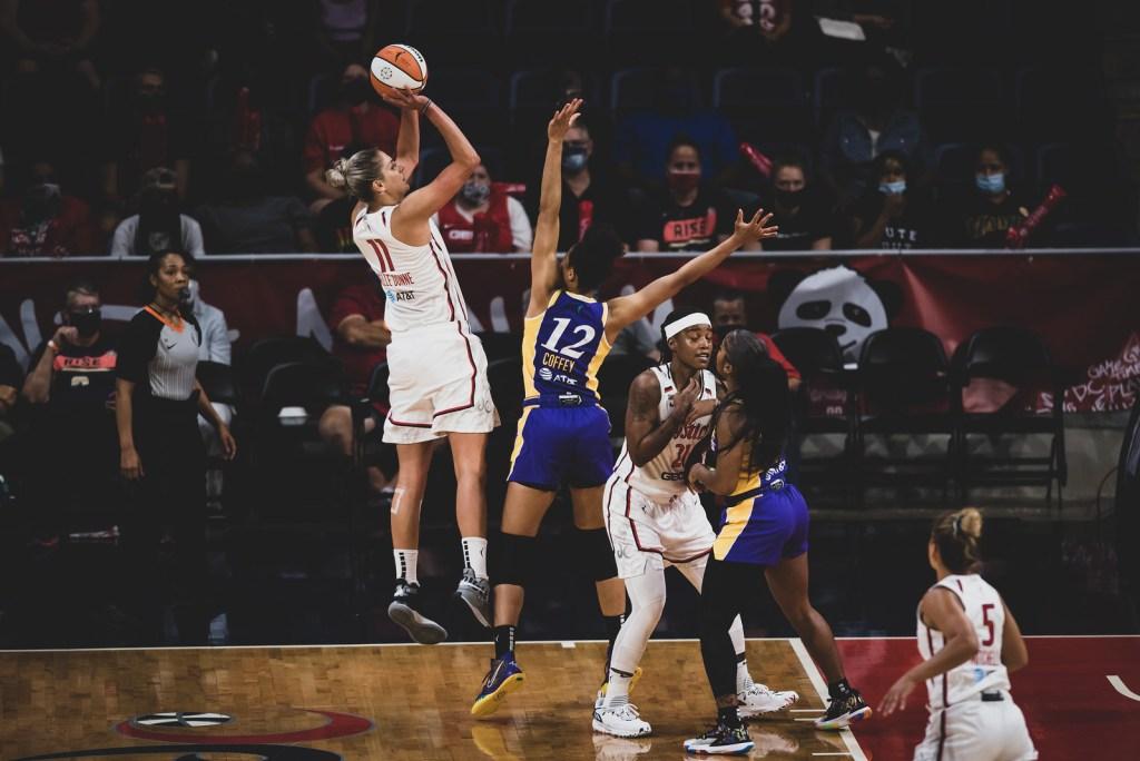 Los Angeles Sparks forward Nia Coffey playing defense