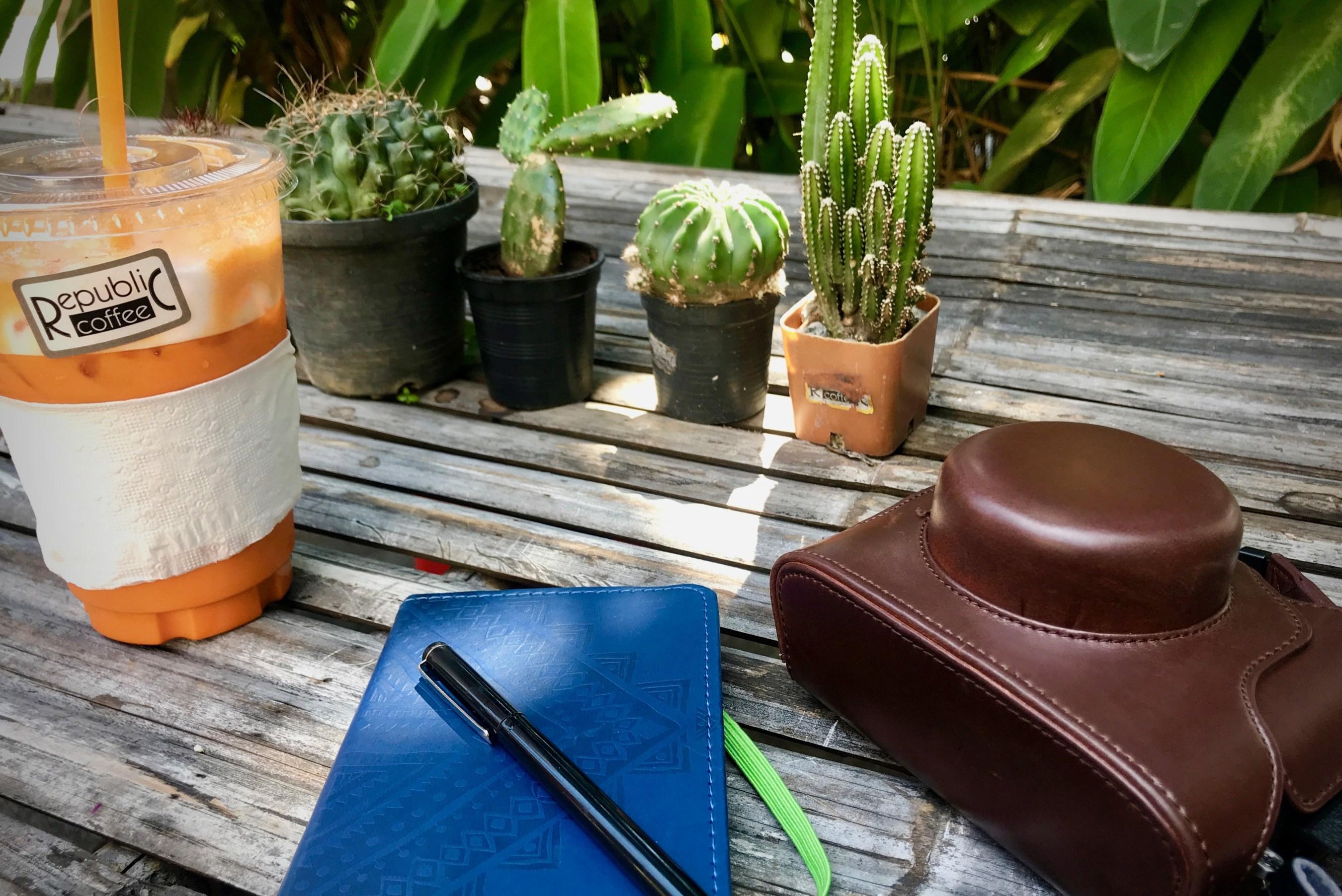 journal and camera at thai tea shop