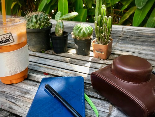 journal and camera at thai tea shop