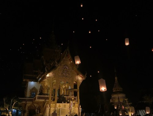 lanterns floating over temple in chiang mai