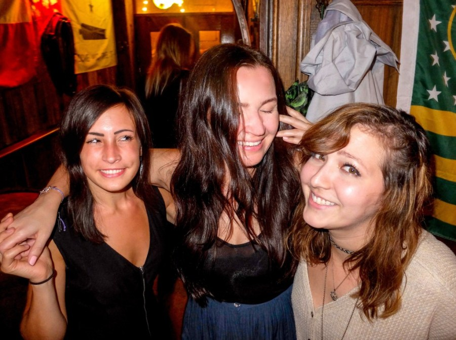 girls laughing at bar