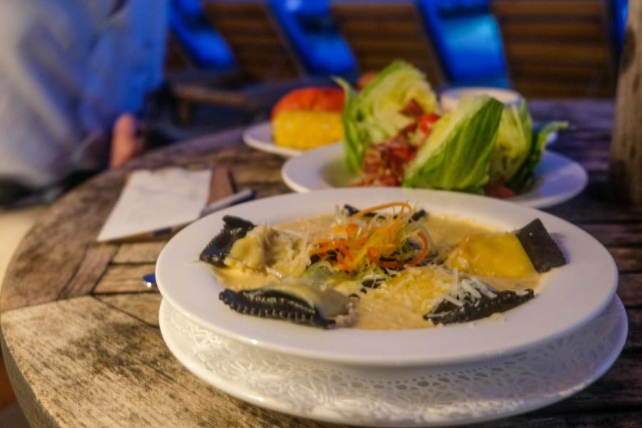 lobster ravioli and salad on dinner table