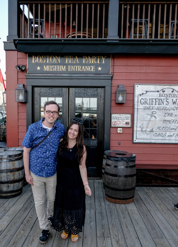 Couple posed in front of Boston Tea Party Ships and Museum