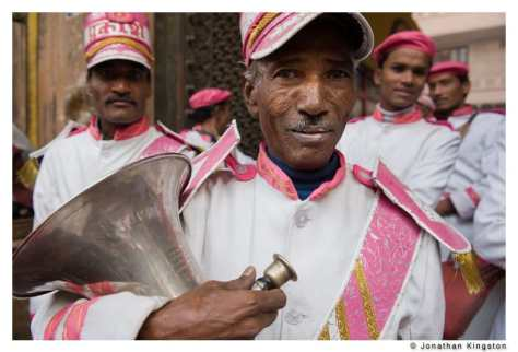 A band of musicians prepares to play for a wedding in Mathura, India.