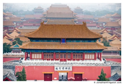 A lone person walks through the north gate of the Forbidden City, Beijing, China, a UNESCO world heritage site.