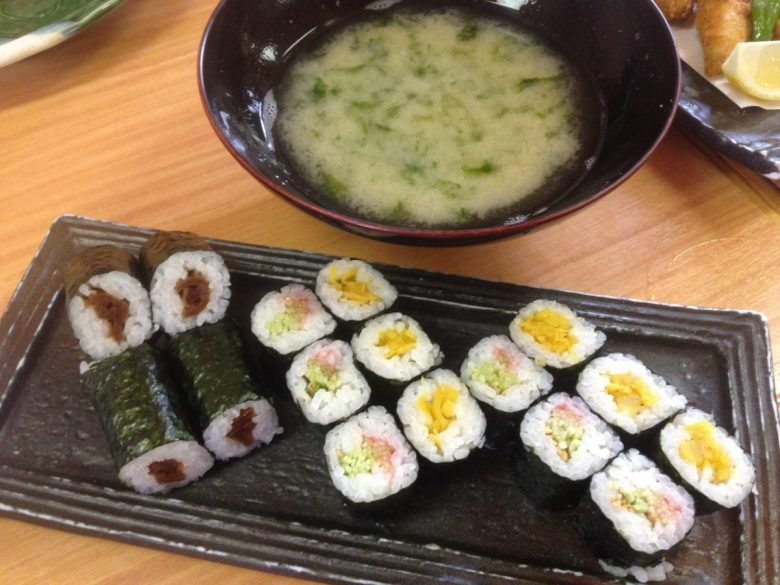 Miso soup and sushi with picked vegetables and plums - vegan in Japan