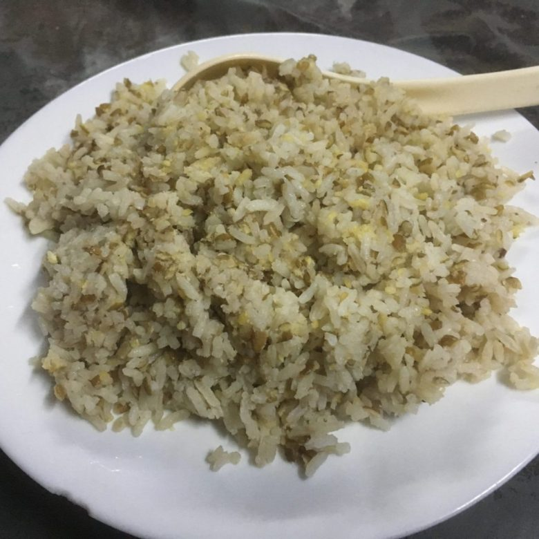 arroz o'loco - feijão cute or cowpeas mixed with rice - tasty African food