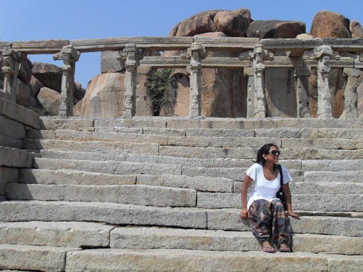Prachi exploring the ruins of Hampi on a vegan tour of India