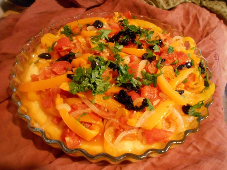 Polenta topped with cooked vegetables