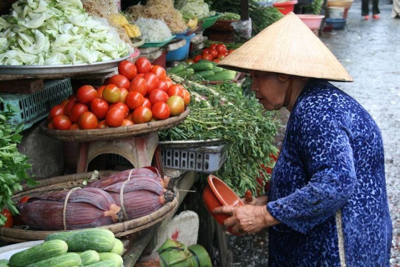 A local woman at a vegetable market in the Mekong delta, Vietnam