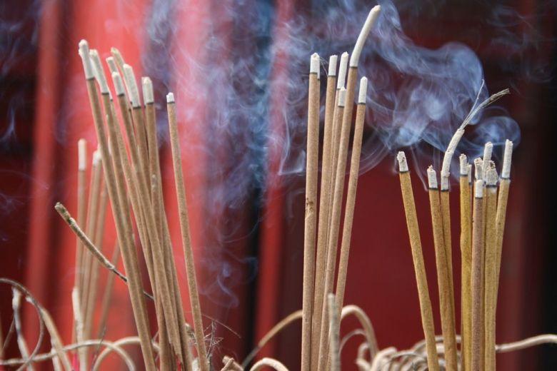 Incense burning outside Den Ngoc Son temple in Hanoi, Vietnam