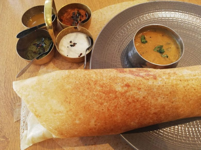 The Masala Dosa at Veganapati is so big it hangs off the plate!