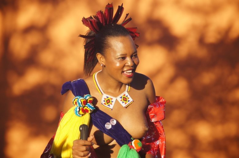 A member of the Swaziland royal family, identifiable by the feathers in her hair.