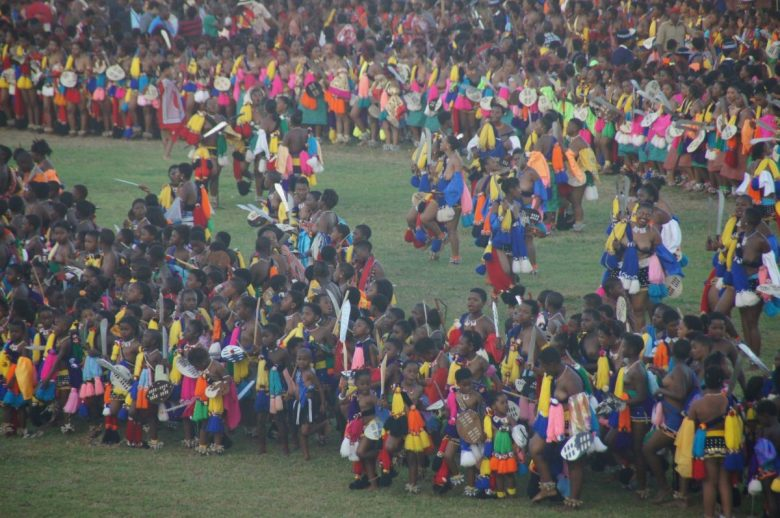 The culmination of the Umhlanga Festival, when the Swazi maidens dance to together in the stadium as dusk falls.